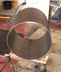 The rolled steel to form the furnace outer skin