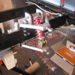 Spring and double wishbone front suspension for ride in van