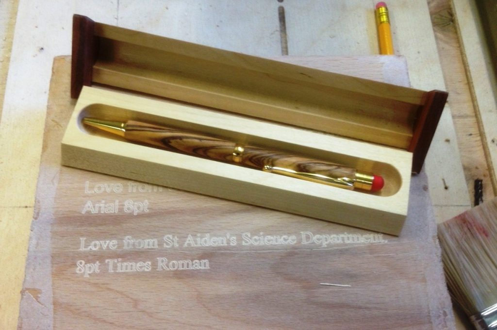 Turned wood pens I sell when requested.