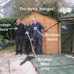 Three brothers work to clear site